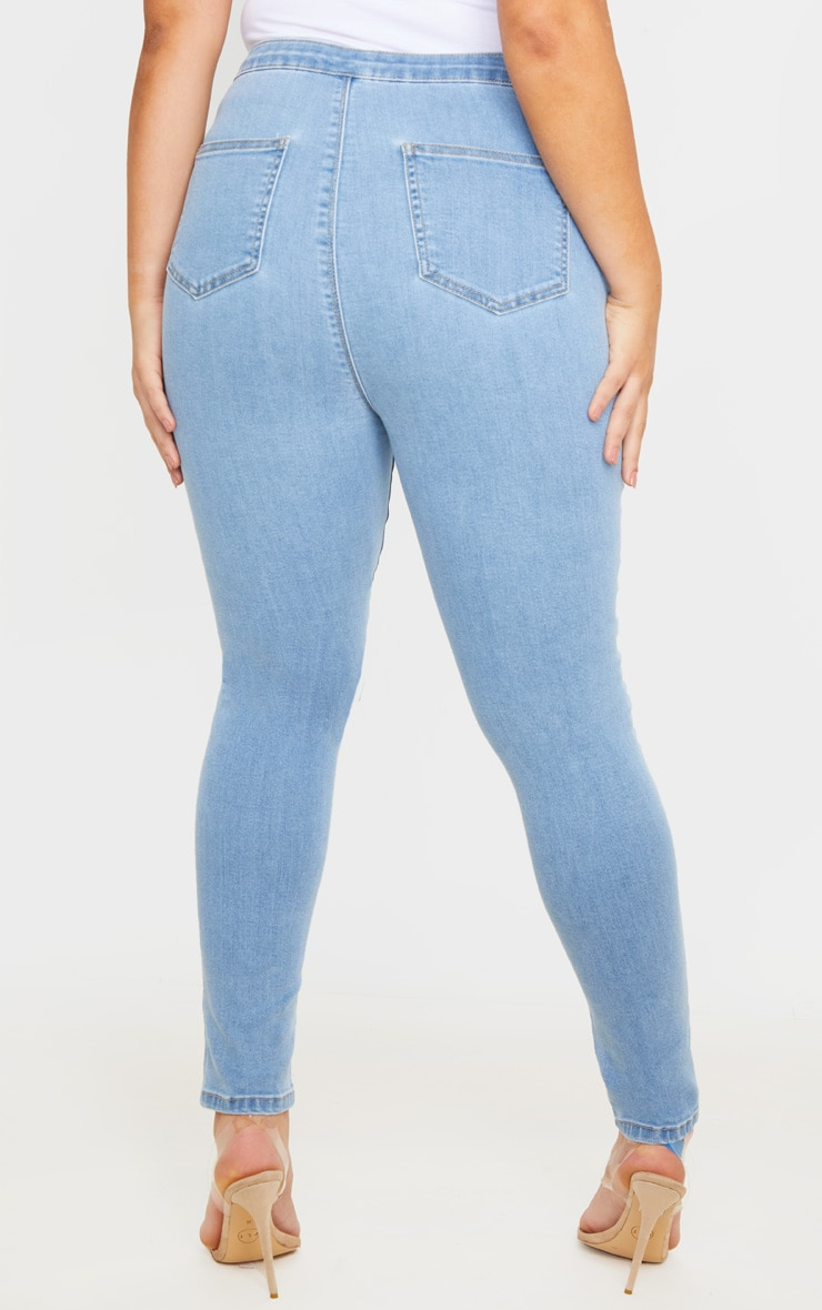 PRETTYLITTLETHING Plus Light Wash Knee Rip Disco Skinny Jean 4