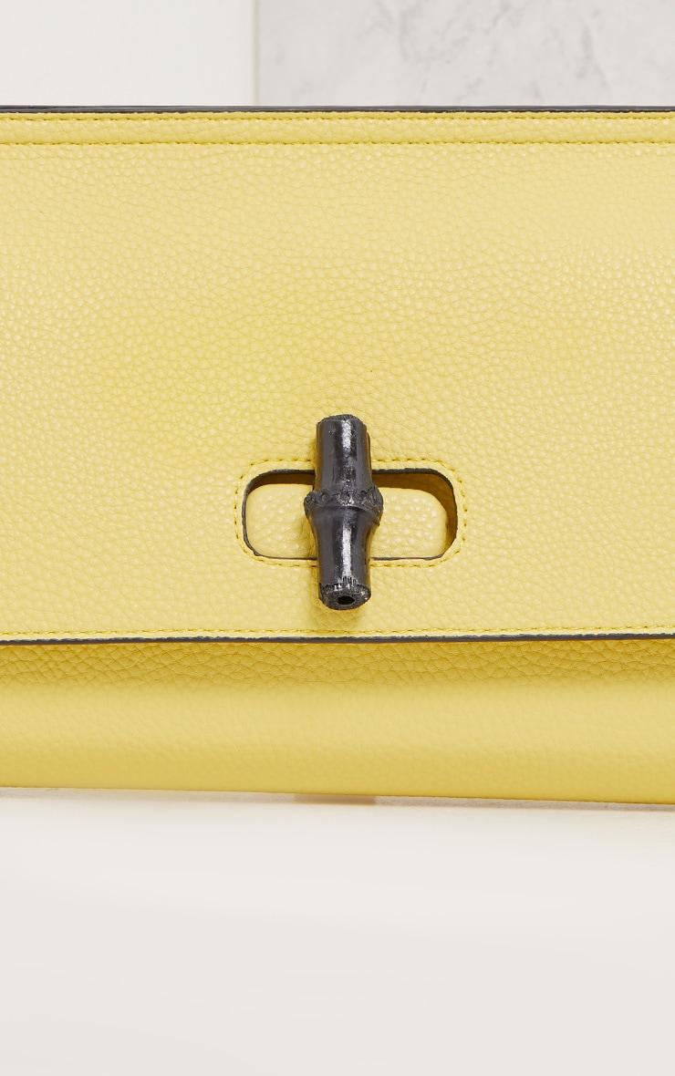 Nennie Yellow Twist Lock Clutch 5