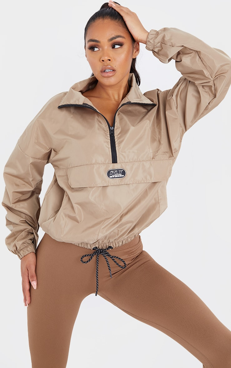 PRETTYLITTLETHING Sand Pull Over Jacket 1