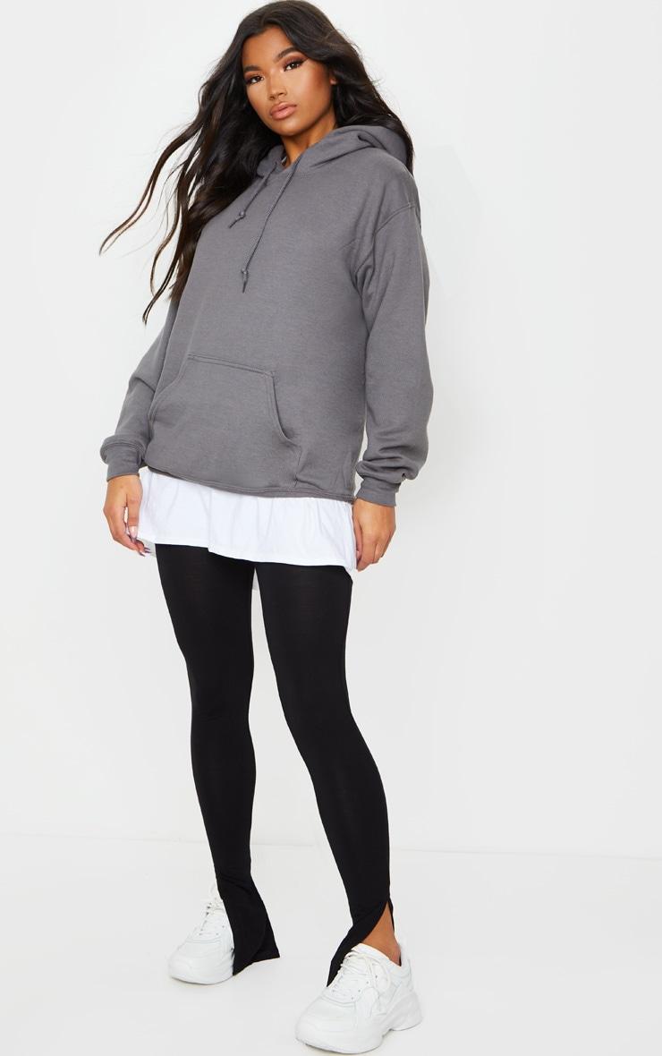 Legging basique en jersey noir à ourlet fendu 1
