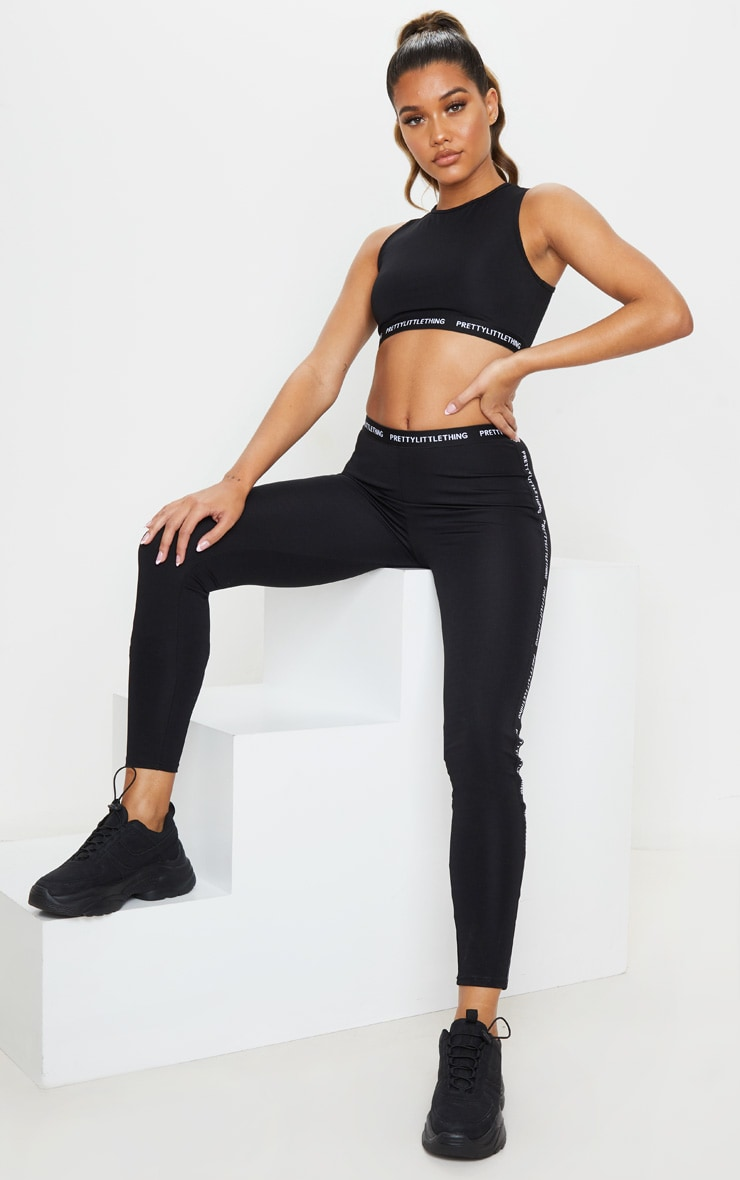 PRETTYLITTLETHING Black High Neck Cropped Gym Top 4