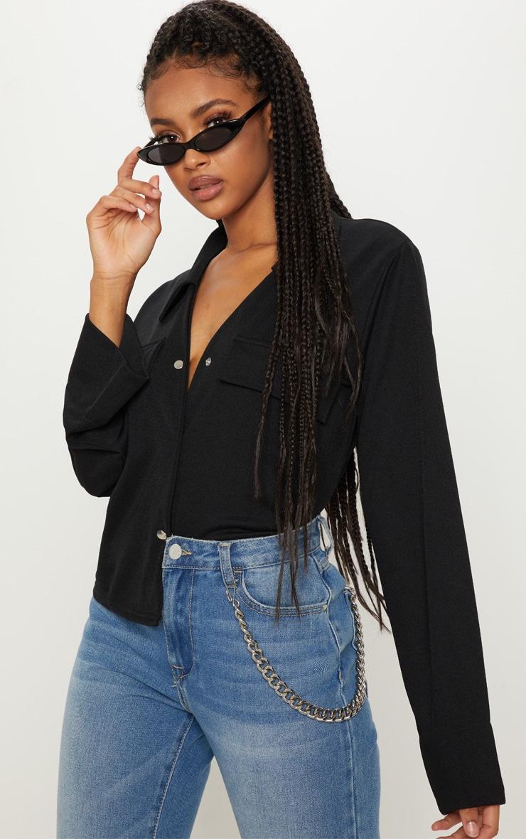 Chemise noire oversized à détail poches 1