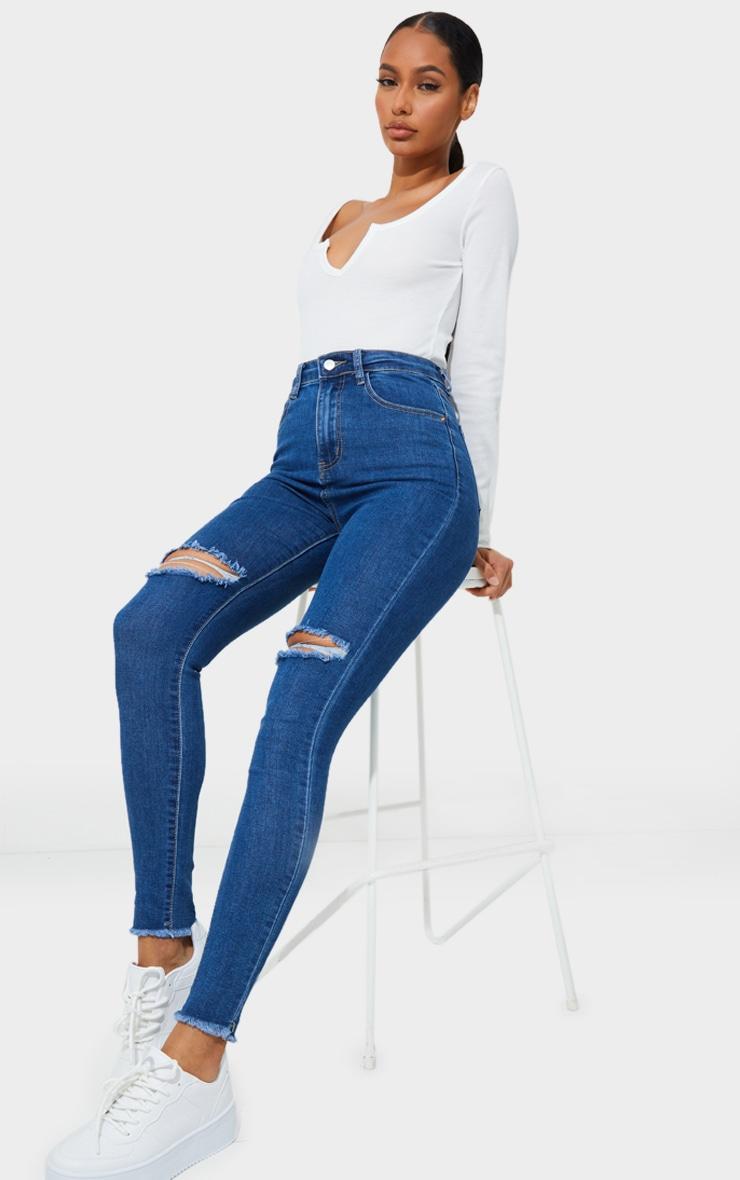 PRETTYLITTLETHING Mid Blue Wash Open Knee Raw Hem 5 Pocket Skinny Jeans 1