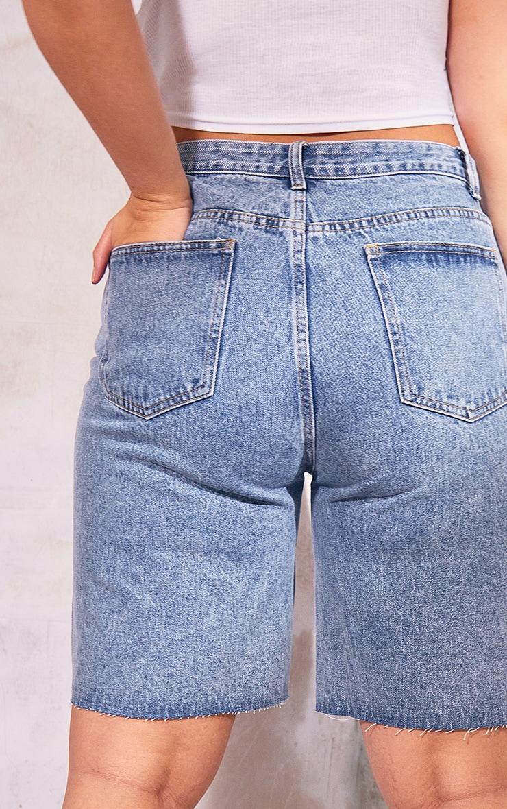 PRETTYLITTLETHING Plus Mid Blue Wash Longline  Fitted Denim Shorts 5