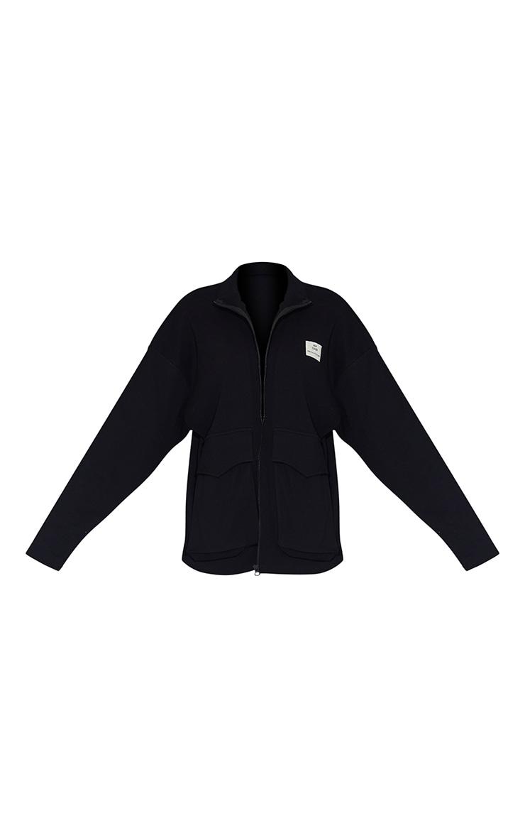PRETTYLITTLETHING - Veste noire côtelée à poche devant et badge New Season 5