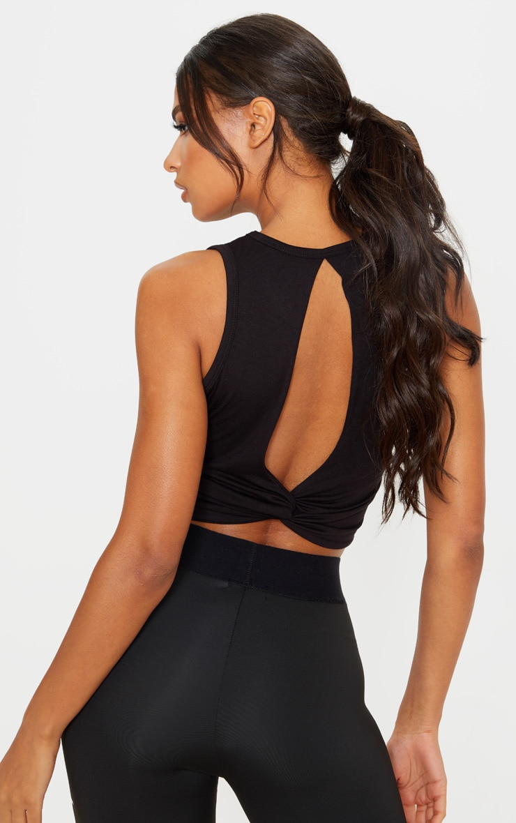 PRETTYLITTLETHING Black Knot Back Cropped Gym Top 5
