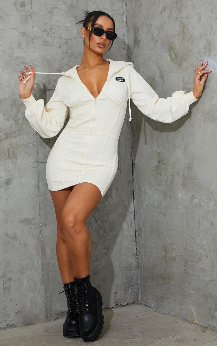 PRETTYLITTLETHING Cream Badge Rib Waist Detail Zip Up Jumper Dress 1