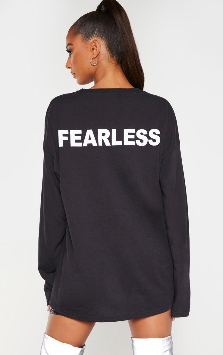T-shirt manches longues noir à slogan Fearless au dos 1