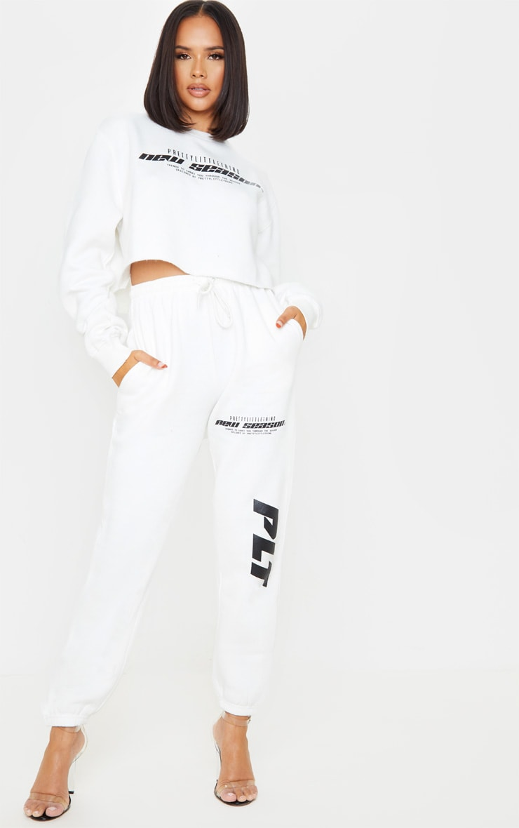 PRETTYLITTLETHING Cream New Season Slogan Joggers 1