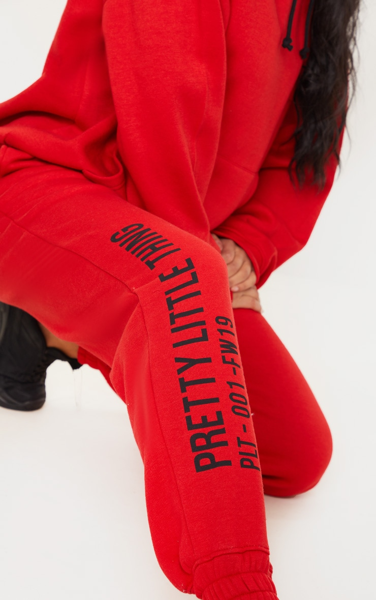 PRETTYLITTLETHING Red Slogan Printed Joggers 4