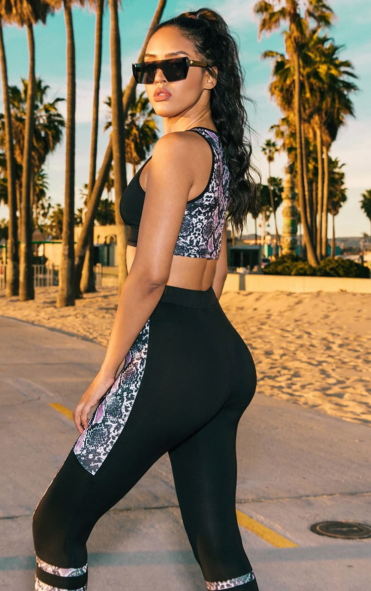 PRETTYLITTLETHING Black High Neck Snake Back Gym Top 1