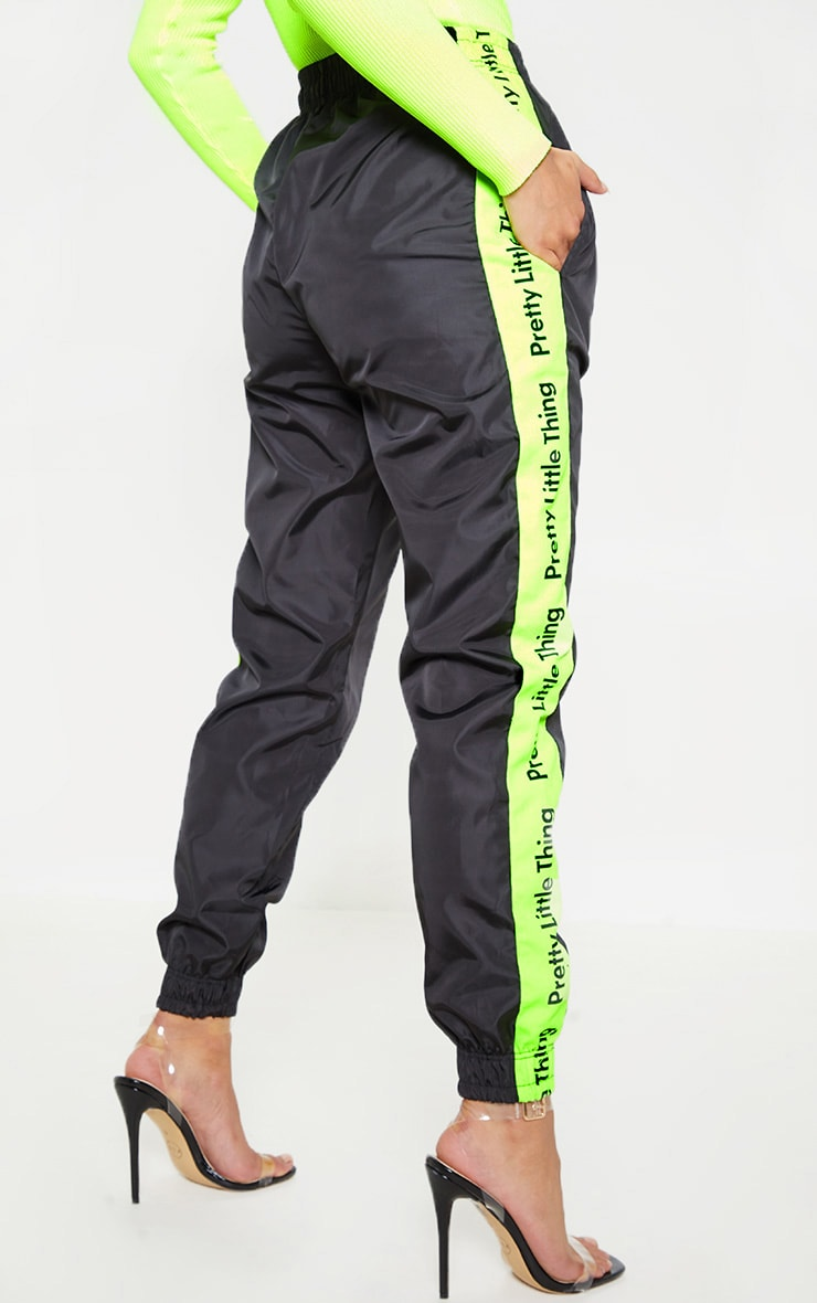 PRETTYLITTLETHING Black Neon Side Tape Shell Jogger 4