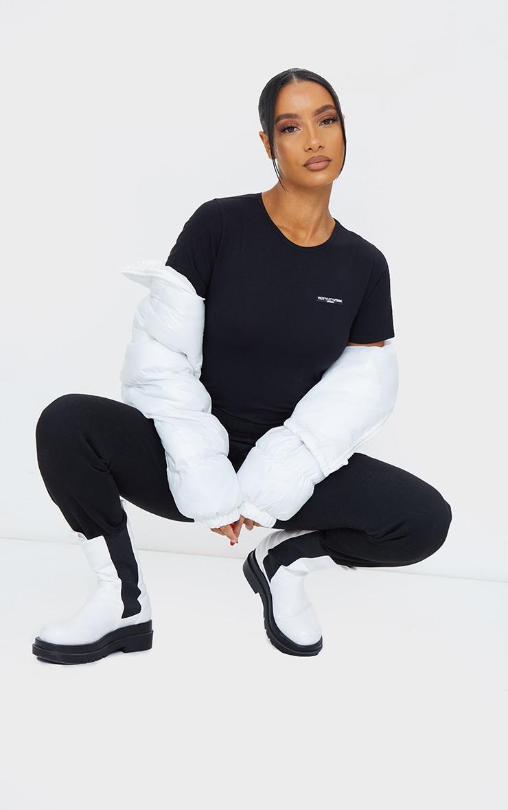 PRETTYLITTLETHING Black Cotton Badge Detail Bodysuit 1