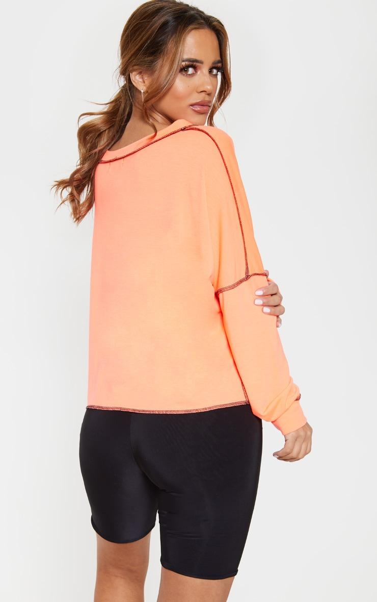 PRETTYLITTLETHING Petite Neon Orange Loose Fit Slogan Top  2