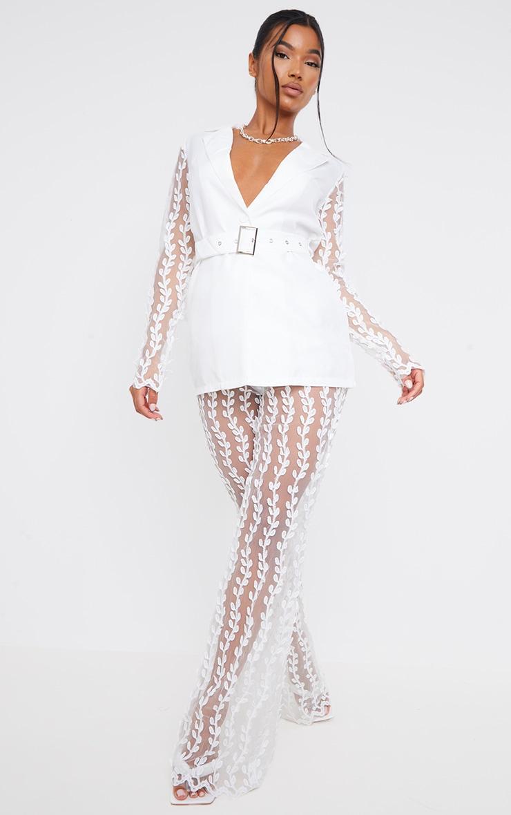 Pantalon jambes évasées blanc transparent en dentelle 1
