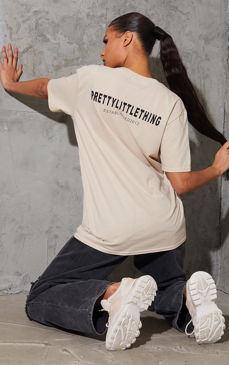PRETTYLITTLETHING Sand Established Back Print T Shirt 1