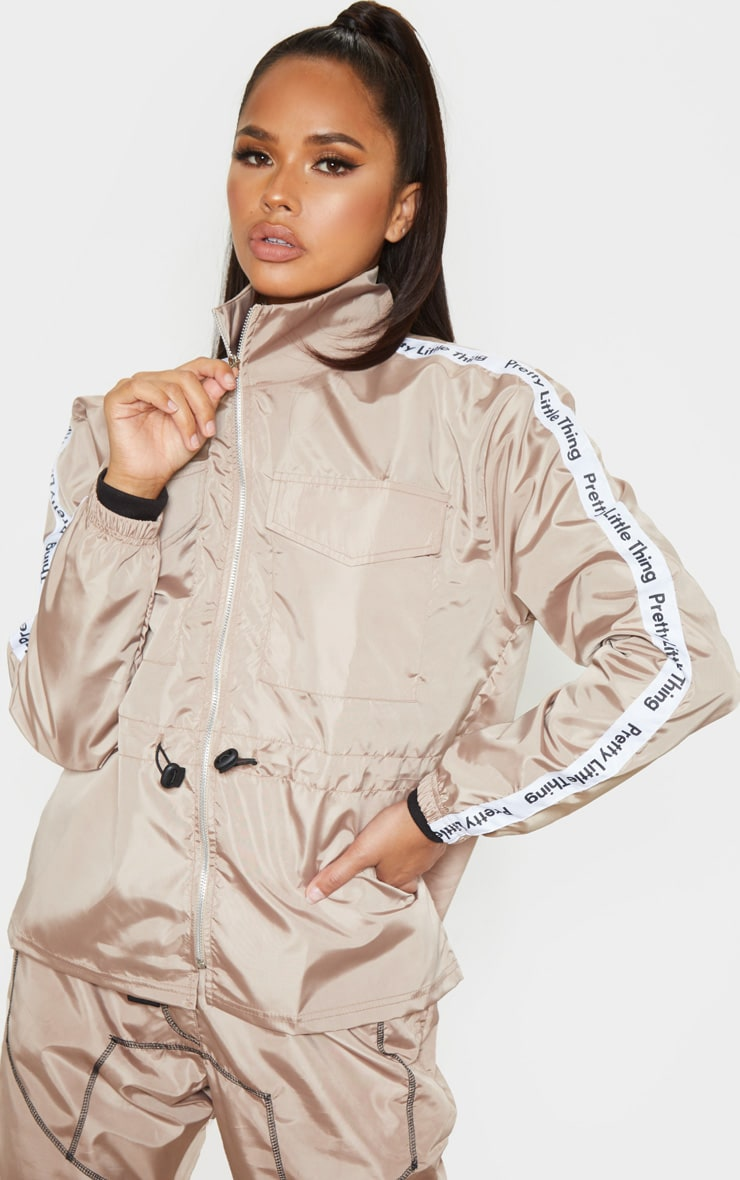 prettylittlething-stone-shell-tie-waist-tracksuit-jacket by prettylittlething
