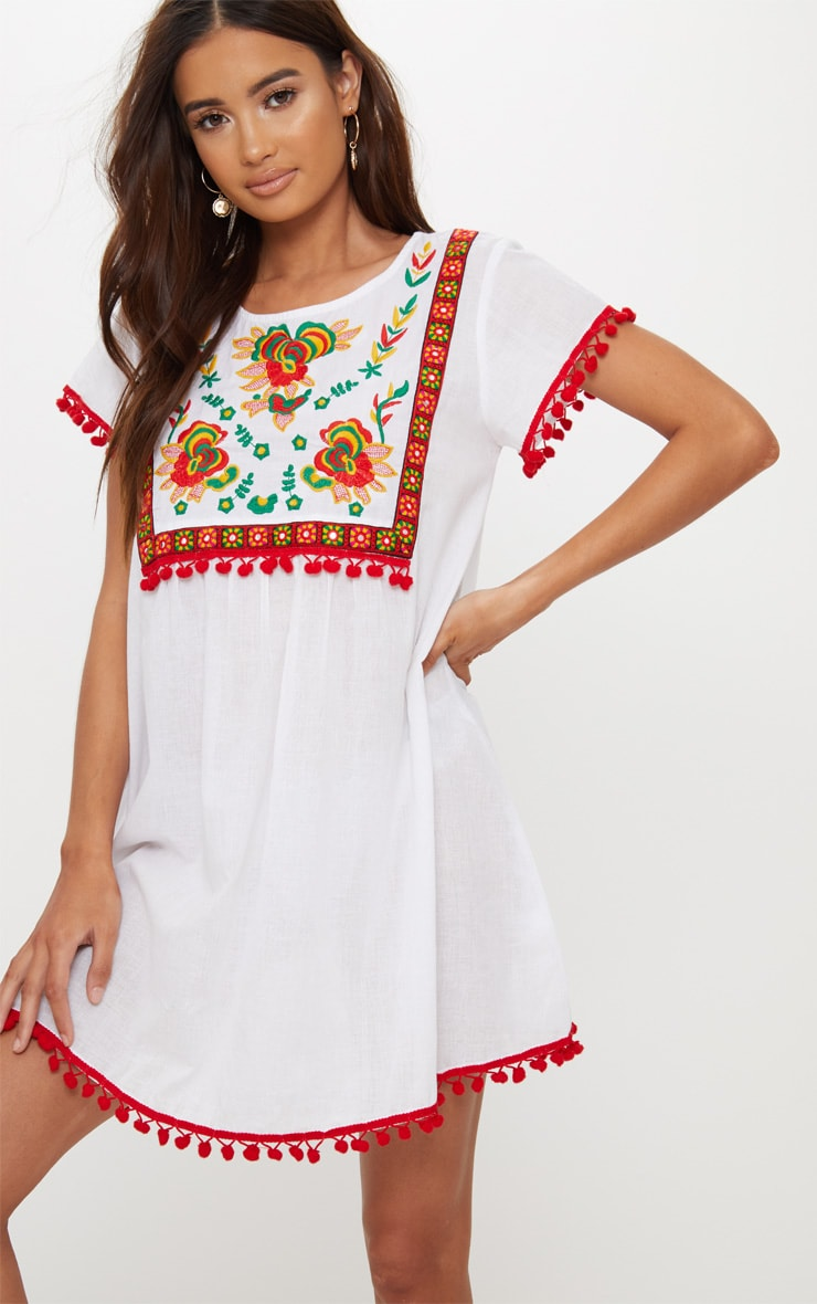db5ba04b7d44 White Embroidered Pom Pom Trim Smock Dress image 1