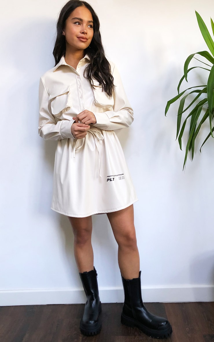 PRETTYLITTLETHING Cream Faux Leather Slogan Pocket Detail Shirt Dress 3