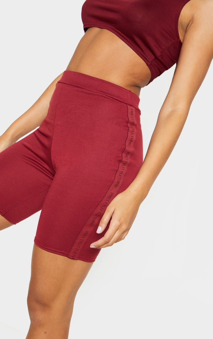 PRETTYLITTLETHING Maroon Side Tape Cycle Short  6