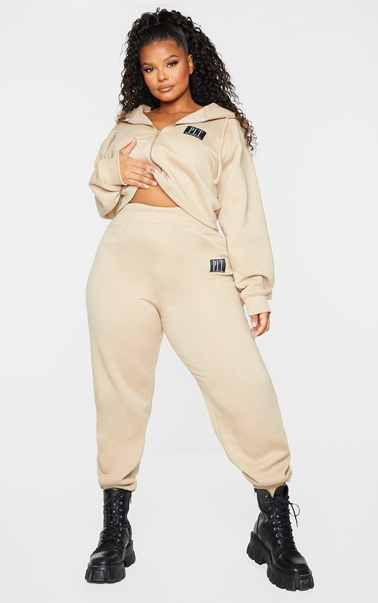 PRETTYLITTLETHING Plus Stone Badge Track Pants