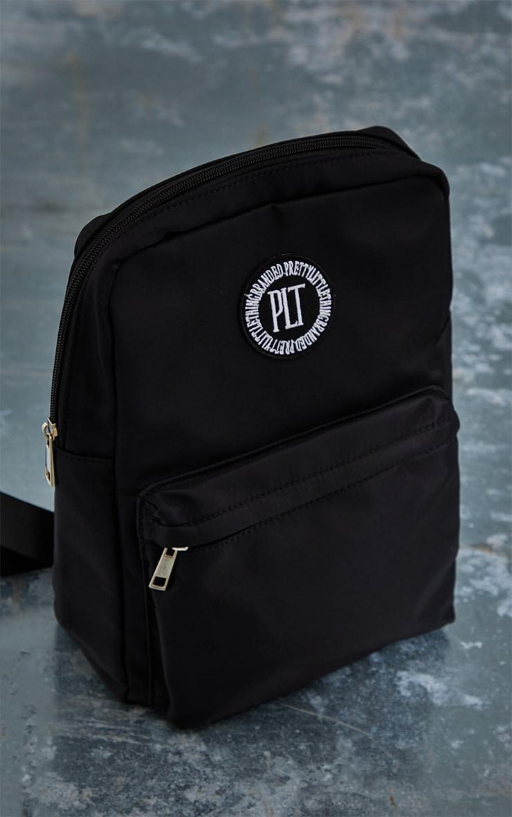PRETTYLITTLETHING Black Round Badge Backpack 2