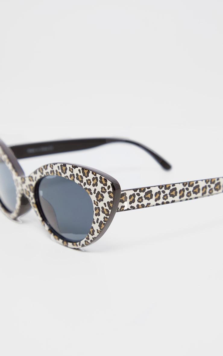 Lunettes de soleil XXL oeil de chat noires à monture léopard 4