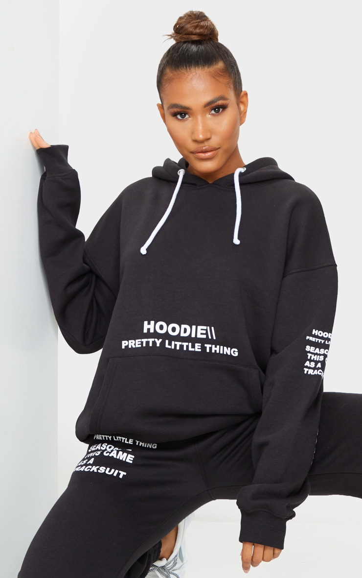 PRETTYLITTLETHING Black Oversized Slogan Print Pocket Front Hoodie 1