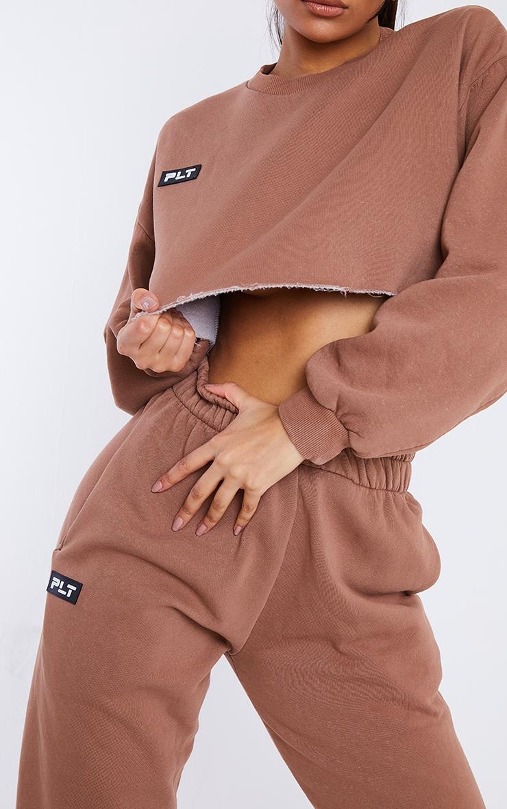 PRETTYLITTLETHING Mocha Washed Badge Detail Cropped Raw Hem Oversized Sweater 4