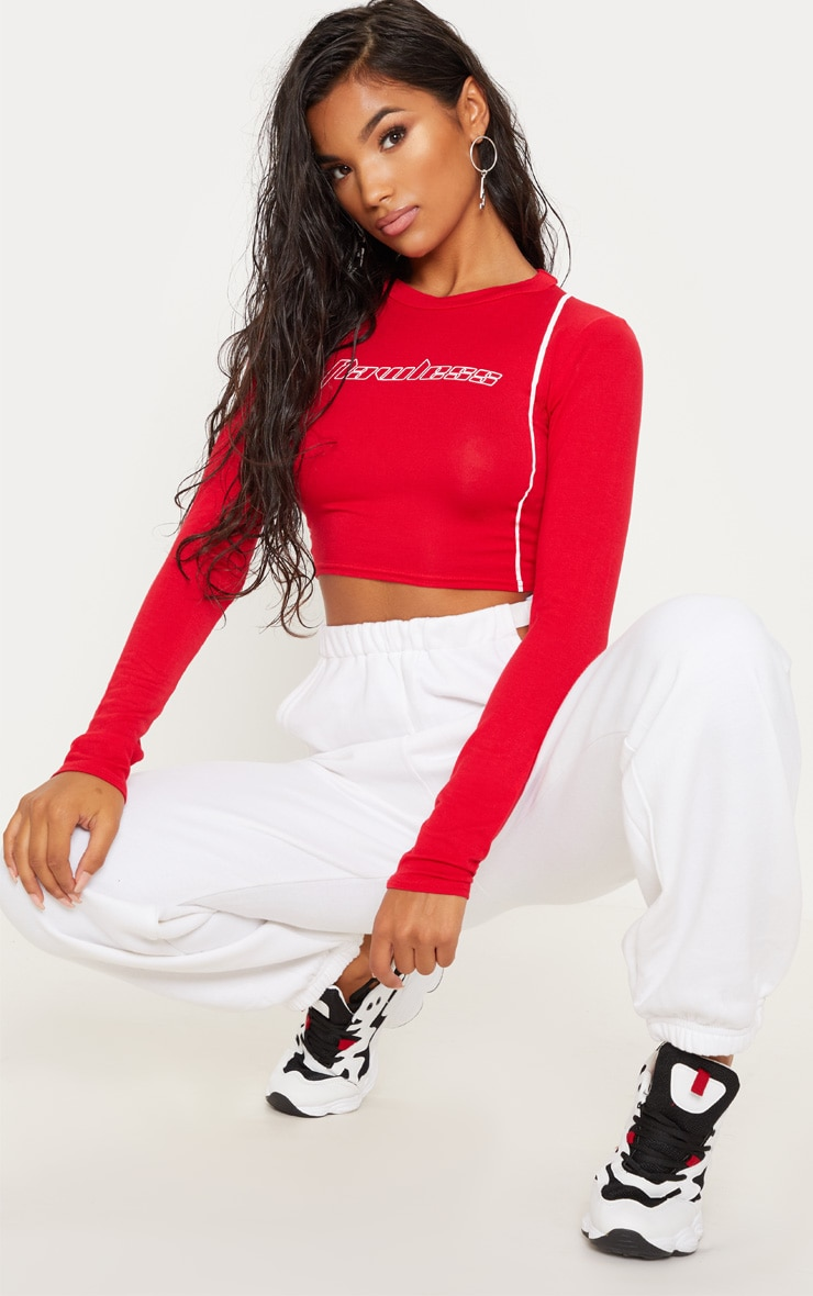 516aa4a265f Red Flawless Slogan Long Sleeve Crop Top   PrettyLittleThing USA