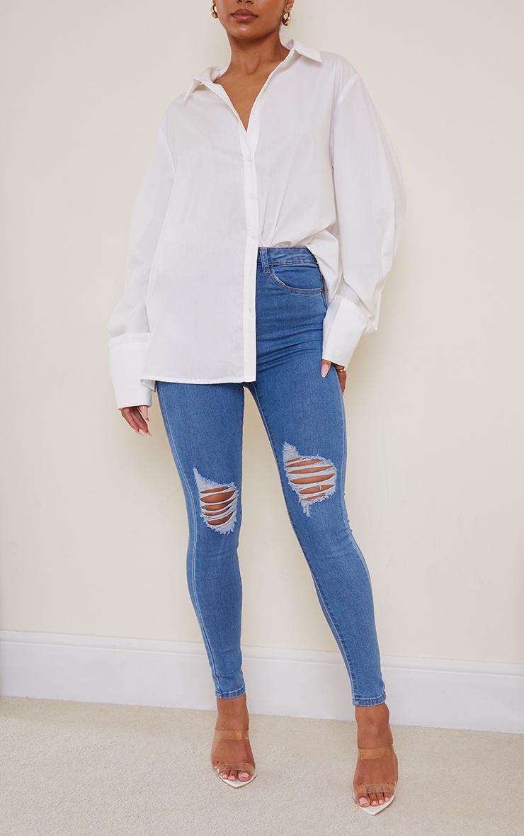 PRETTYLITTLETHING Light Wash Knee Rip 5 Pocket Skinny Jean 2
