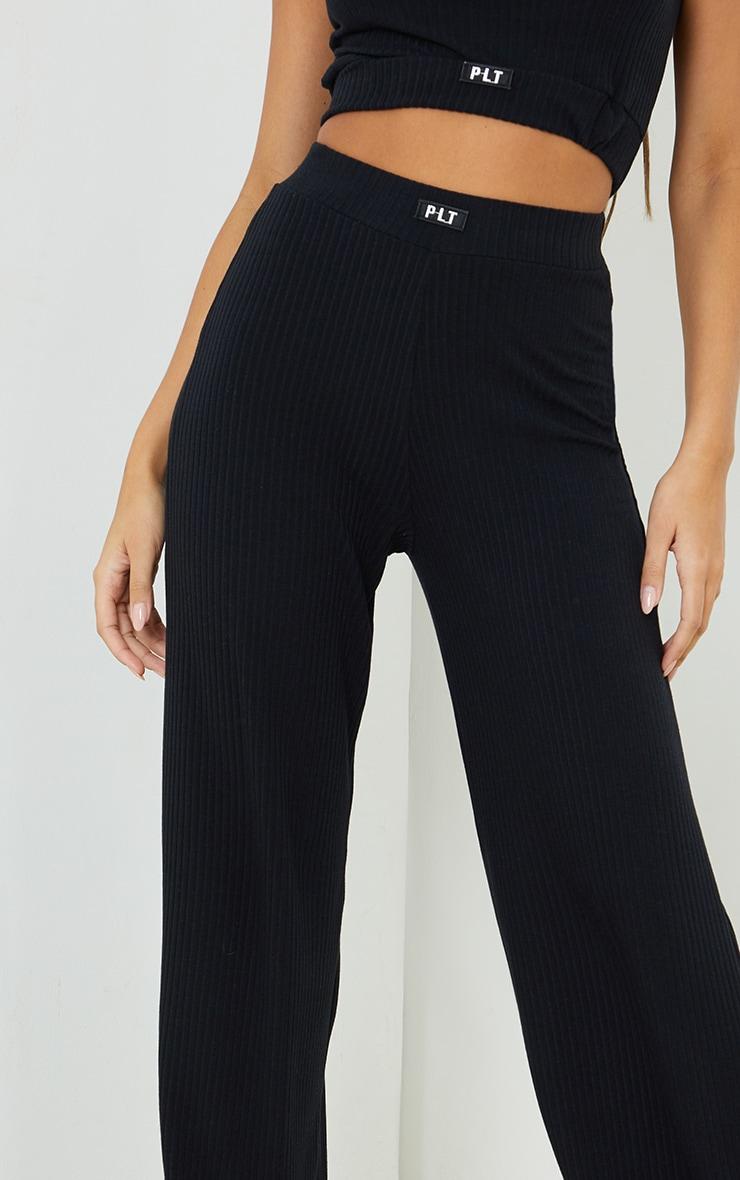 PRETTYLITTLETHING Black Badge Detail Rib Wide Leg Trousers 4
