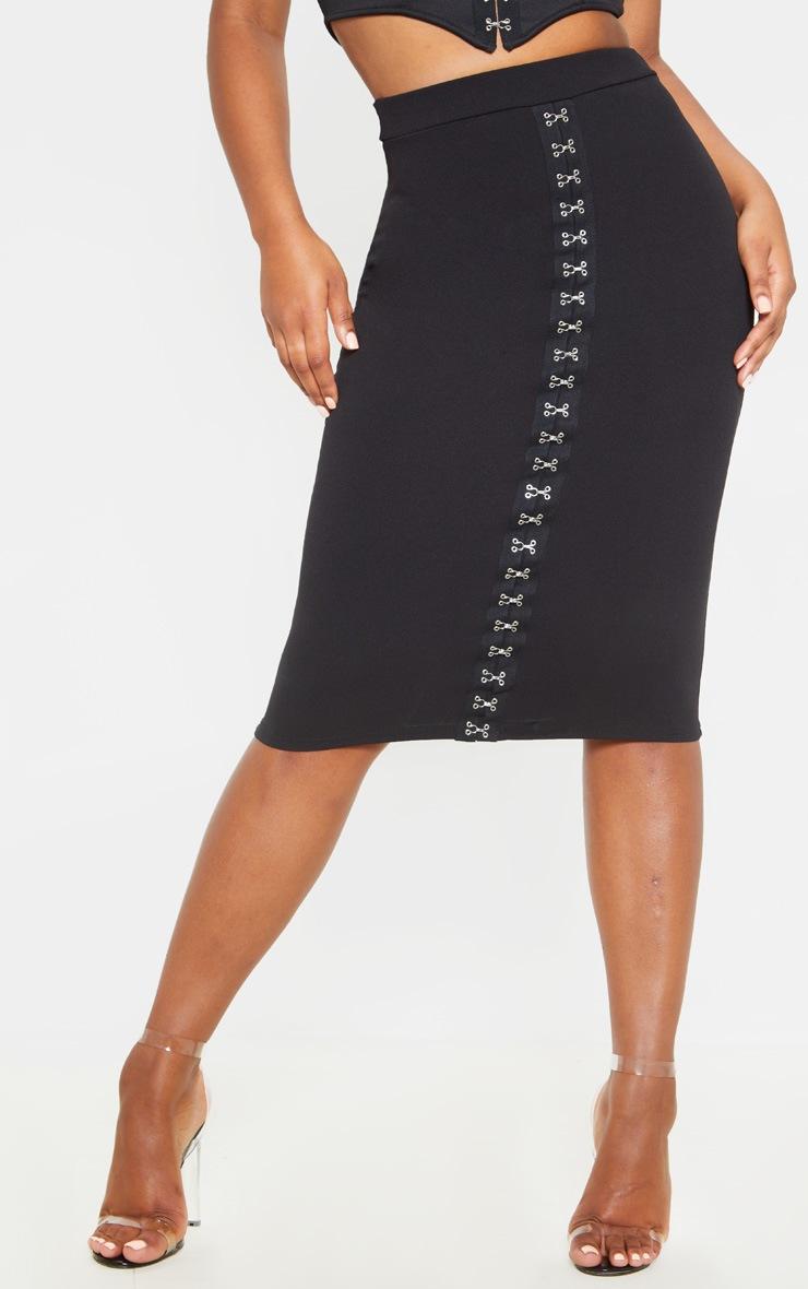 Jupe mi-longue noire à détail oeillets et lacets 2