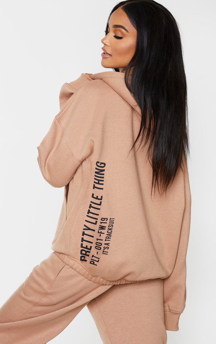 PRETTYLITTLETHING Mocha Oversized Slogan Back Pocket Front Hoodie 2