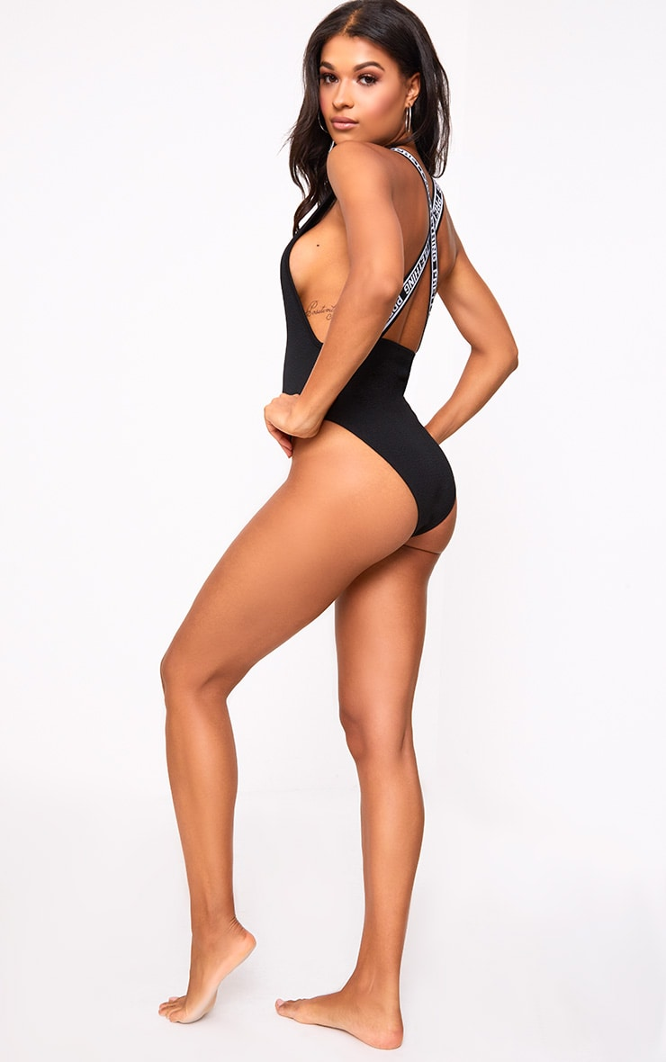 PRETTYLITTLETHING Black Strap Beach One Piece 5