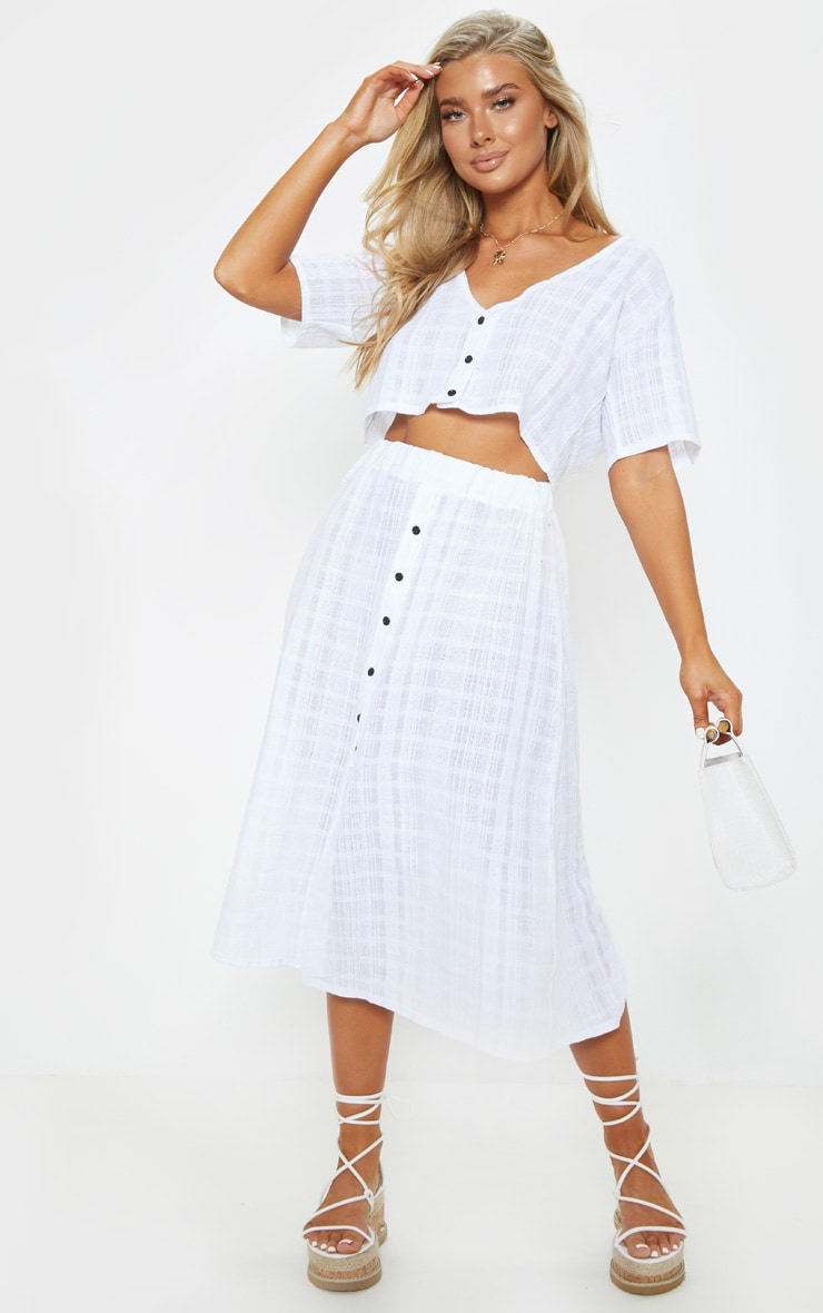 1b6b234086b97 White Cotton Button Up Beach Skirt | Swimwear | PrettyLittleThing AUS