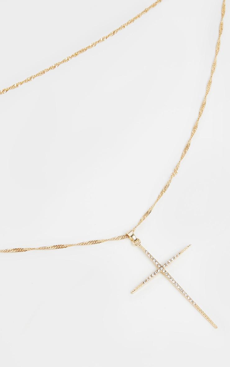 Collier superposé doré torsadé à pendentif croix 1