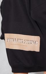 PRETTYLITTLETHING Black Contrast Slogan Oversized Sweat Jumper Dress 4