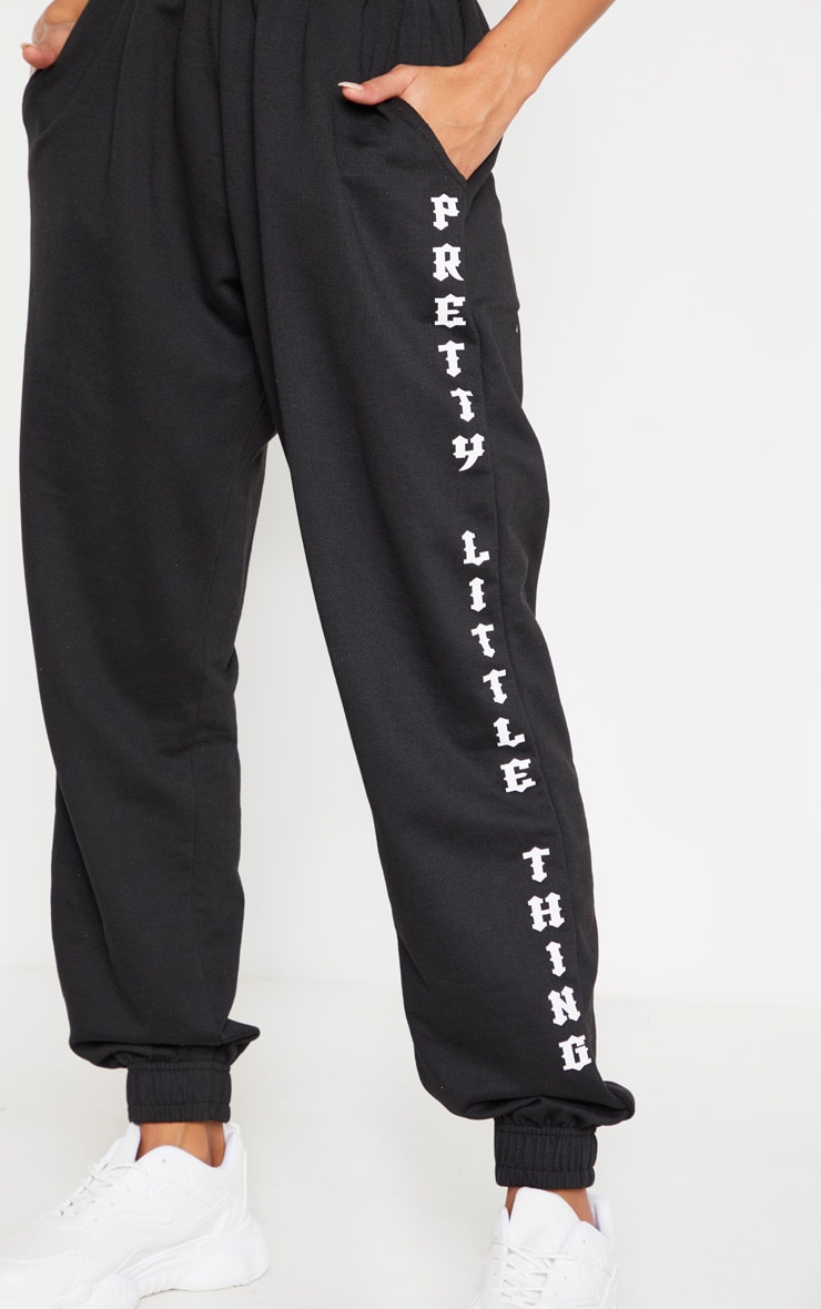 PRETTYLITTLETHING Black Slogan Side Joggers 5