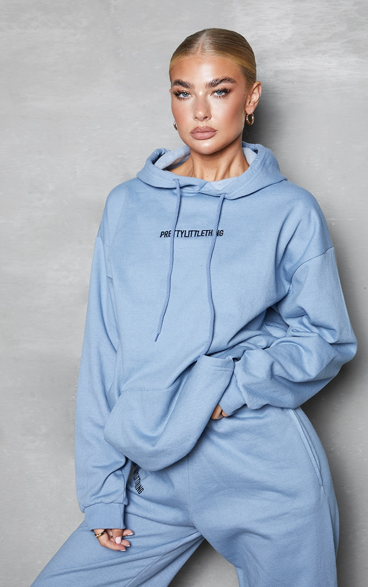 PRETTYLITTLETHING Blue Steel Embroidered Slogan Hoodie 1
