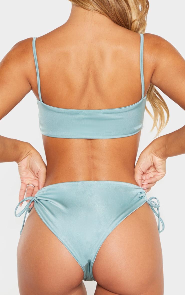 Bas de bikini turquoise cendré et cordons sur les côtés 3