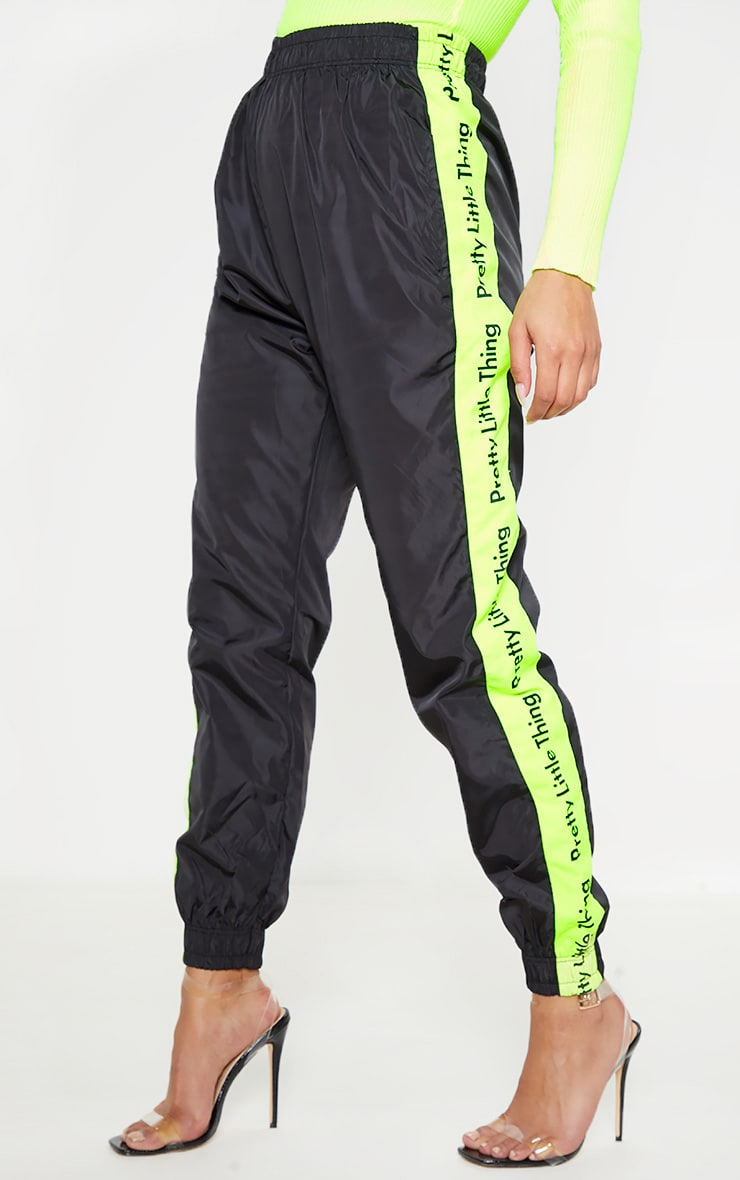 PRETTYLITTLETHING Black Neon Side Tape Shell Jogger 2