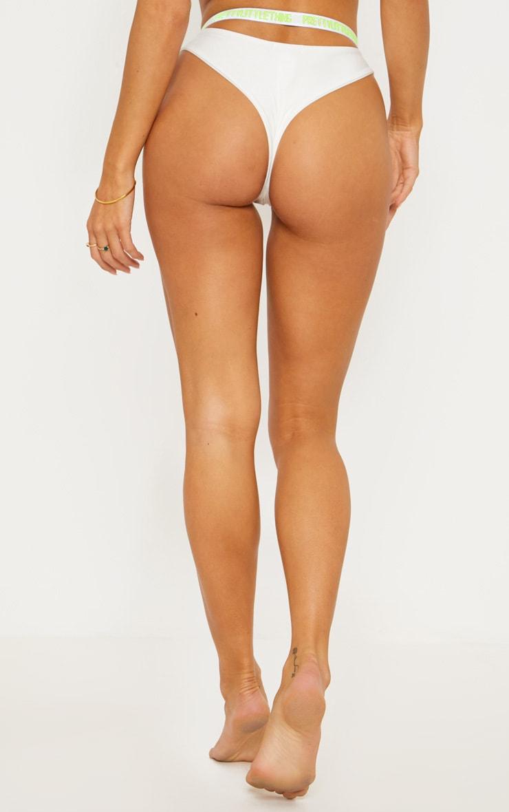 PRETTYLITTLETHING White Fluorescent Cut Out Bikini Bottom 4