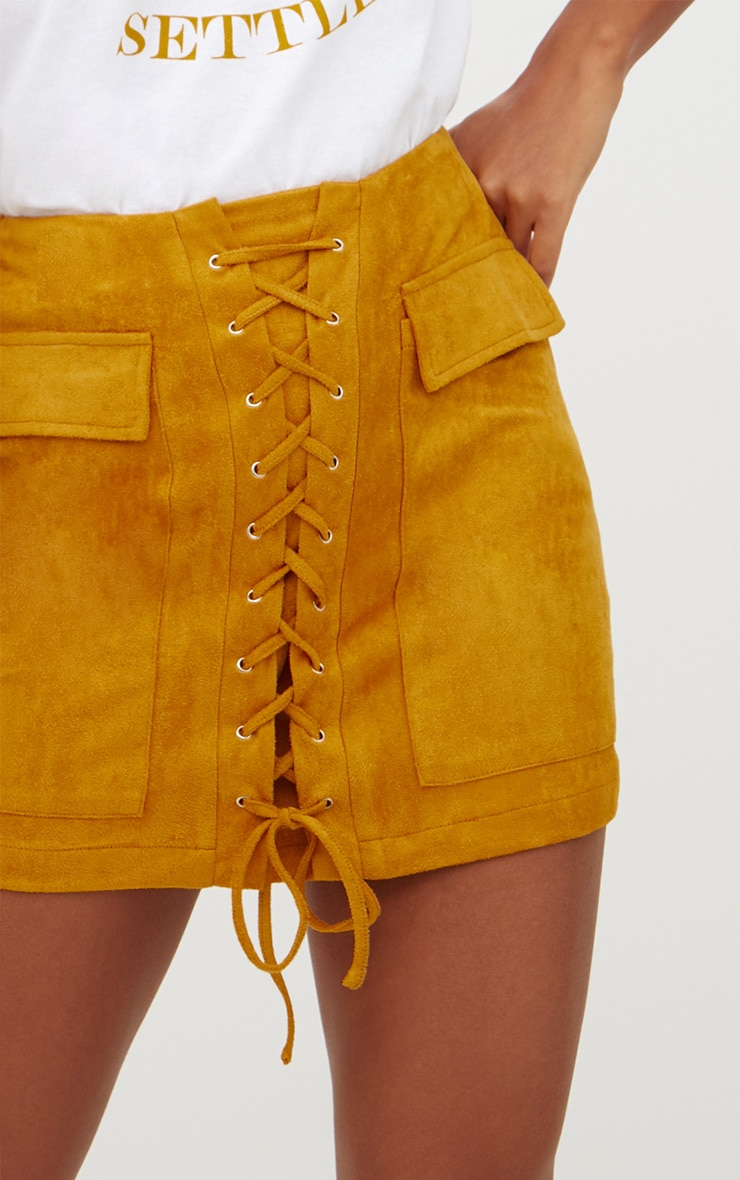 06b84325f0 Mustard Faux Suede Lace Up Mini Skirt | PrettyLittleThing