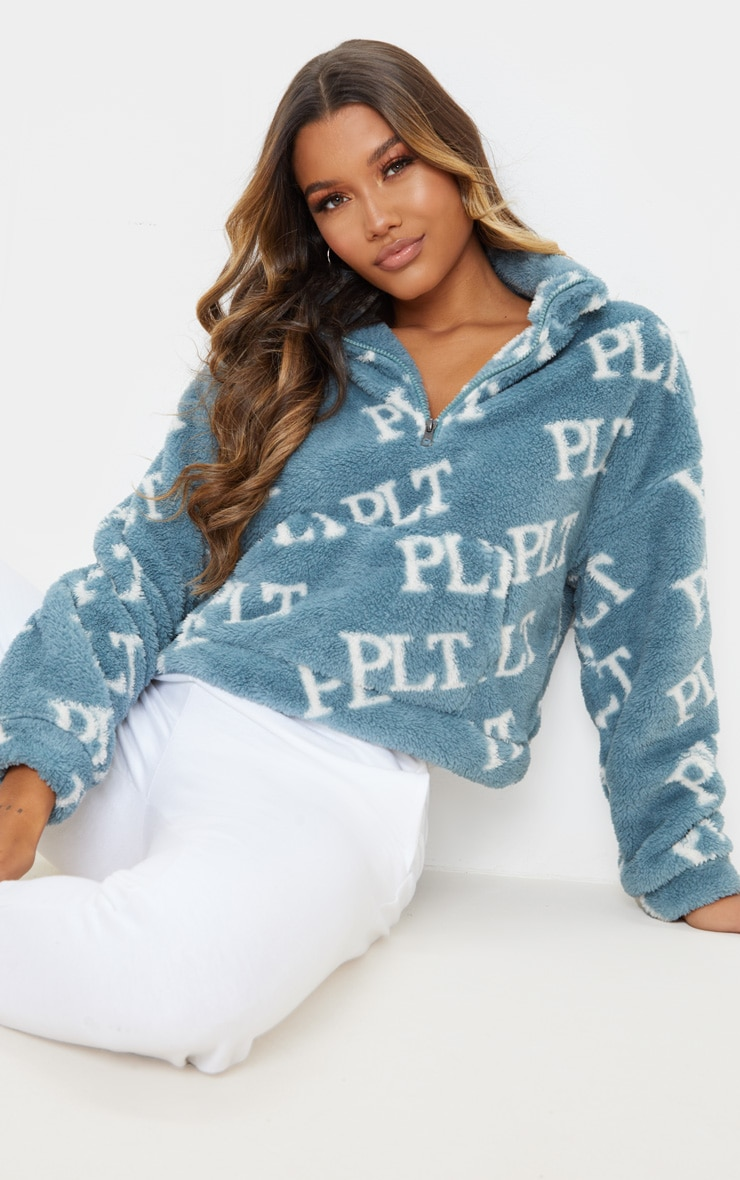 PRETTYLITTLETHING Teal Printed Zip Borg Crop Sweater 1