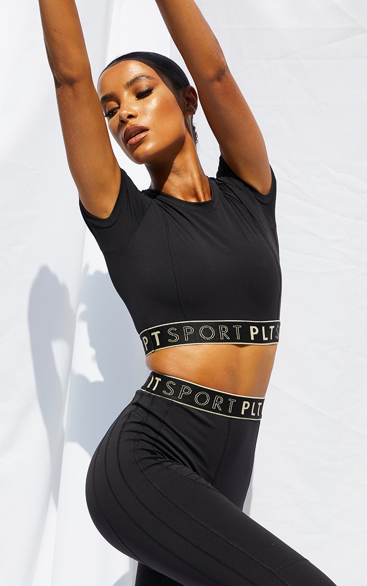 PRETTYLITTLETHING Black Sculpt Luxe Cropped Short Sleeve Gym Top 1