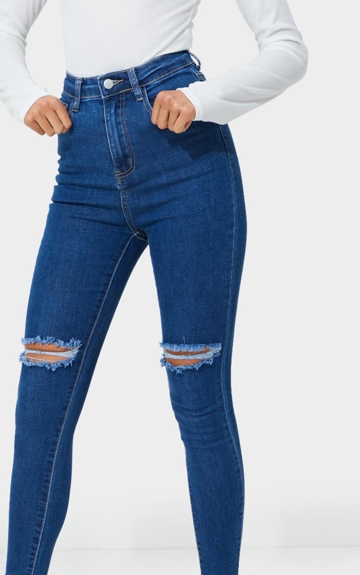 PRETTYLITTLETHING Mid Blue Wash Open Knee Raw Hem 5 Pocket Skinny Jeans 4