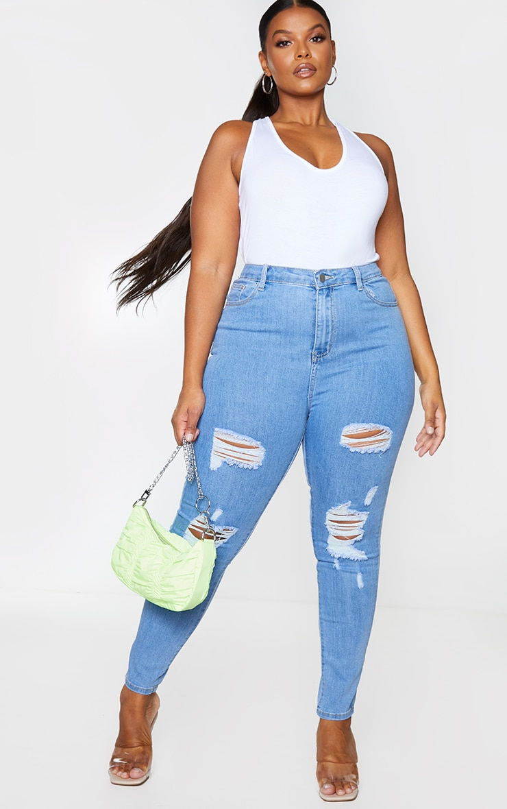 PRETTYLITTLETHING Plus Light Wash Distressed 5 Pocket Skinny Jean 1