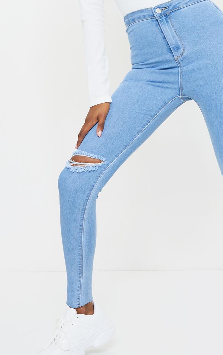 PRETTYLITTLETHING Tall Light Blue Wash Raw Hem Knee Rip Disco Skinny Jean 4