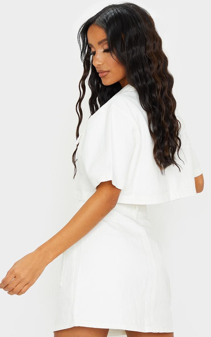 Chemise manches courtes en jean blanc à boutons et détail poches 2